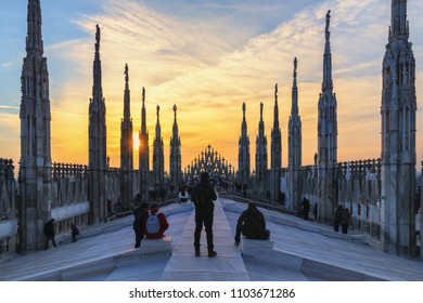 Milan, Italy - March 8, 2015: At top of the Milan Cathedral at sunset