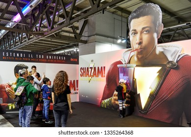 Milan, Italy - March 8 2019 Cartoomics Comic Con  visitors play and pose for photos at Shazam promotional stand