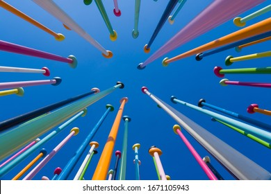 Milan, Italy - March 8, 2020: Colorful poles against blue sky, the sculpture named Coloris, in the public park at City Life district, new residential area, in Milan.
