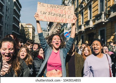 MILAN, ITALY - MARCH 8: Secondary school students celebrate the International Women's Day on MARCH 8, 2018 in Milan, showing a sign that reads If abortion is homicide a blowjob.