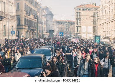 MILAN, ITALY - MARCH 8: Secondary school students take part in a march to celebrate the International Wome's Day on MARCH 8, 2018 in Milan.