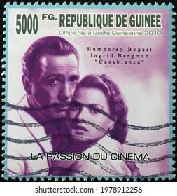 Milan, Italy - May 08, 2021: Humphrey Bogart and Ingrid Bergman on postage stamp