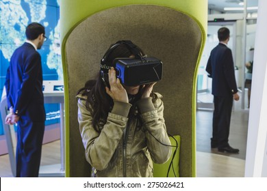 MILAN, ITALY - MAY 1: Woman tries virtual reality headset at Expo, universal exposition on the theme of food on MAY 1, 2015 in Milan.