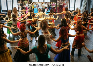 Milan, Italy - may 12, 2015: Women's group in costume at a indoor belly dance lesson in fitness classroom