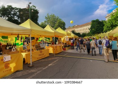 Milan, Italy - May 12 2018: Milano Food Week. Crowd on outdoor food market around Piazza Castello during the second year of event dedicated to healthy nutrition and lifestyle.