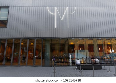 Milan, Italy - May 12 2018: MUDEC Museo delle Culture facade. Museum of Culture of Milan courtyard entrance with museum logo at Via Tortona 56.
