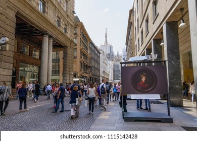 Milan, Italy - May 12 2018: Corso Vittorio Emanuele II with crowd. Day view of pedestrian area of fashion street stores in Milano. Duomo church visible in the background.