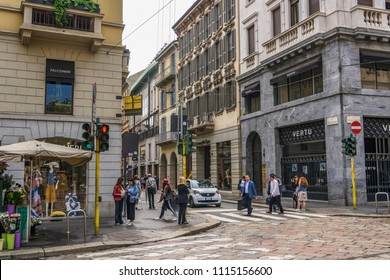 Milan, Italy - May 12 2018: Via Monte Napoleone shopping street. Window shopping people at Milano fashion district with Montenapoleone sign.
