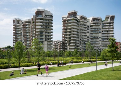 Milan, Italy - May 13, 2018: People relaxing and doing fitness in CityLife distric green area in Milan