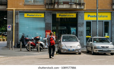 Milan, Italy - May 13th, 2018: Poste Italiane branch. Besides providing core postal services, Poste Italiane SpA offers integrated products such as postal savings, logistics and financial services