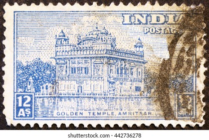 Milan, Italy - May 17, 2015: Golden temple on vintage indian postage stamp