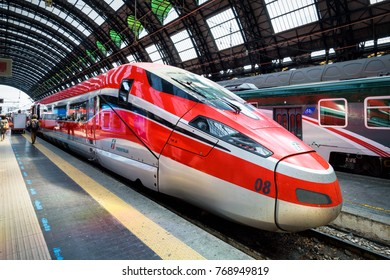 Milan, Italy - May 17, 2017: Modern high-speed train at the Milan Central Station. Travel destinations of Italy. Industrial landmarks of Milan. Traveling and transport in Milan and Italy.