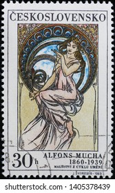 Milan, Italy - May 17, 2019: Allegory of Painting painted by Alfonse Mucha on stamp