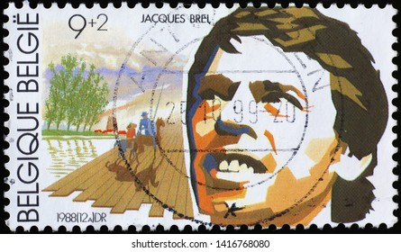 Milan, Italy - May 17, 2019: Portrait of Jacques Brel on belgian postage stamp