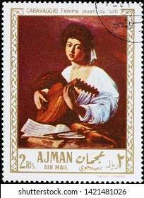 Milan, Italy - May 17, 2019:  Young woman playing lute, painting by Caravaggio on stamp