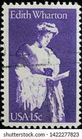 Milan, Italy - May 17, 2019: Edith Wharton on vintage american postage stamp