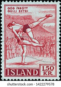 Milan, Italy - May 17, 2019: Couple of wrestlers on ancient icelandic postage stamp