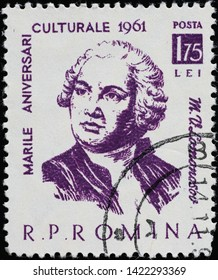 Milan, Italy - May 17, 2019:  Scientist Mikhail Lomonosov on old romanian stamp