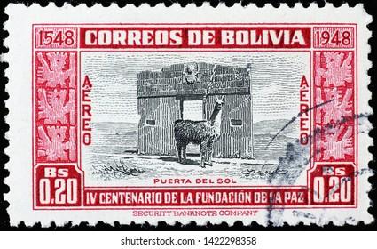 Milan, Italy - May 17, 2019: Pre-hispanic monument and Llama on vintage bolivian stamp