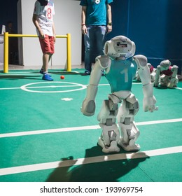 MILAN, ITALY - MAY 17: Nao robot plays soccer at Wired Next Fest, event dedicated to future, innovation and creativity on MAY 17, 2014 in Milan.