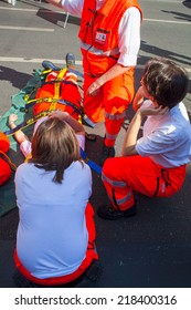 MILAN, ITALY - MAY, 18: Emergency personnel render aid to a girl during an emergency simulation on May 18, 2014