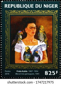 Milan, Italy - May 19, 2020: Self-portrait with parrots by Frida Kahlo on stamp