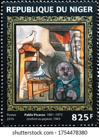 Milan, Italy - May 19, 2020: Painting by Pablo Picasso on postage stamp of Niger