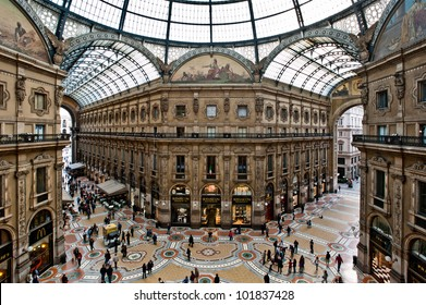 MILAN, ITALY - MAY 2, 2012: Unique view of shops in Galleria Vittorio Emanuele II seen from above. Built in 1875 this gallery is one of the most popular fashion shopping areas in Milano.