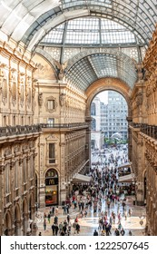 MILAN, ITALY -MAY 2: Above view of Galleria Vittorio Emanuele II with people in Milan on May 2, 2012. Built in 1875,the gallery is one of the most popular landmarkds and shopping areas of Milano