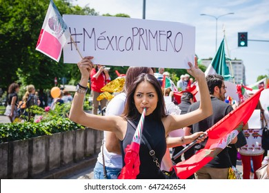 MILAN, ITALY - MAY 20, 2017: Mexican woman taking part in a peaceful demonstration claming equal rights and integration for immigrants and refugees