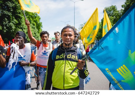 MILAN, ITALY - MAY 20, 2017: Black man taking part in a peaceful demonstration claming equal rights and integration for immigrants and refugees