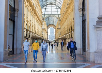 MILAN, ITALY - MAY 20, 2020: Pedestrians wearing protective face masks in Galleria Vittorio Emanuele II, Milan. Italy reopens everything after more than two months of nationwide lockdown.