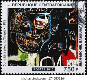 Milan, Italy - May 20, 2020: Portrait of a man by Jean-Michel Basquiat on stamp