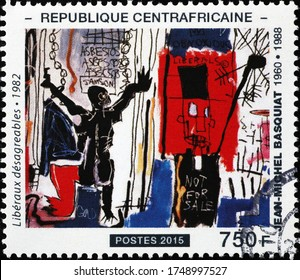 Milan, Italy - May 20, 2020: Unpleasant liberals by Jean-Michel Basquiat on stamp