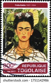 Milan, Italy - May 21, 2020: Self-portrait with animals by Frida Kahlo on stamp