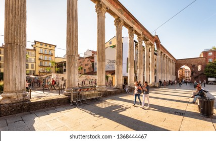Milan, Italy - May 22, 2017: Ancient Columns of San Lorenzo in Milan. It is one of the main landmarks of Milan. Historical architecture in sunset light. Sunny panoramic view of Roman ruins in Milan.