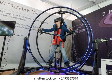 MILAN, ITALY - MAY 24: Girl tries virtual reality space dive machine at Wired Next Fest, event dedicated to future, innovation and creativity on MAY 24, 2019 in Milan.