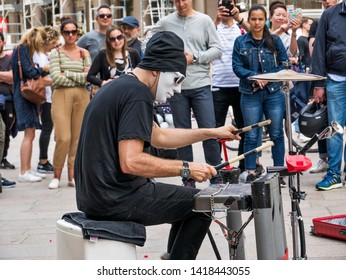 Milan, Italy - May 25, 2019: Masked anonymous percussionist performs in Duomo square Milan