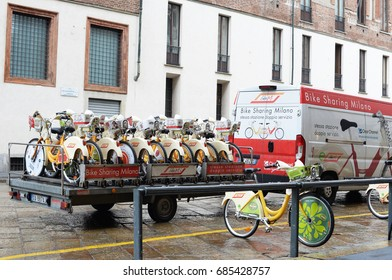 MILAN, ITALY - MAY 4, 2017: bicycles are transported to and from the share places for Bike Mi, the public bike sharing project in Milan City