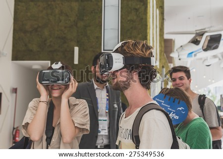 MILAN, ITALY - MAY 4: People trying 3D headset at Expo, universal exposition on the theme of food on MAY 4, 2015 in Milan.