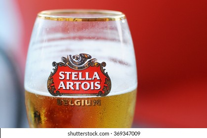 MILAN, ITALY - MAY 5, 2015: A glass of Stella Artois, a traditional Belgian pilsner beer since 1926, one of the prominent brands of Anheuser-Bush Inbev