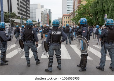 MILAN, iTALY - MAY 5, 2018: Riot police in full tactical gear stand ready to confront anarchic activists during a demonstration in the city streets.