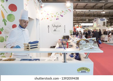 MILAN, ITALY - MAY 6: Cook works at Tuttofood, world food exhibition on MAY 6, 2019 in Milan.