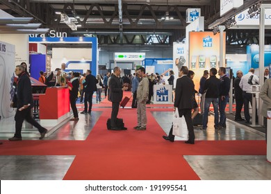 MILAN, ITALY - MAY 7: People visit Solarexpo, international exhibition for promoting innovative and renewable energy technology on MAY 7, 2014 in Milan.