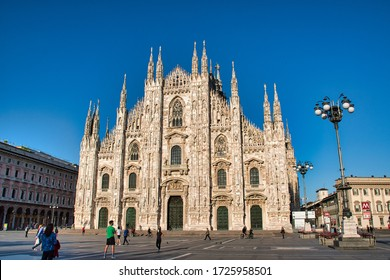 Milan, Italy May 8, 2020: The golden sunshine is reflecting on the front of the magnificent Duomo di Milano or Milan Cathedral after Italy eases coronavirus restrictions after two month lockdown