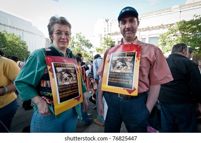 """MILAN, ITALY - MAY 8: A group of dog lovers and their pets attend a demonstration against """"perreras"""", the horrible conditions and atrocities in Spanish kennels on May 8, 2011 in Milan, Italy."""