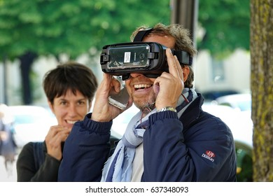 MILAN, ITALY - May 9, 2017: People try outdoors virtual reality headset