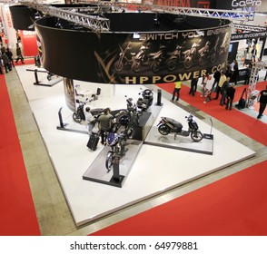 MILAN, ITALY - NOV. 03: Panoramic view of people visiting motorcycles stands at EICMA, 68th International Motorcycle Exhibition November 03, 2010 in Milan, Italy.