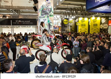 MILAN, ITALY - NOV. 13: People look at details of motorcycles in exhibition at the EICMA, 69th International Motorcycle Exhibition on November 13, 2011 in Milan, Italy.
