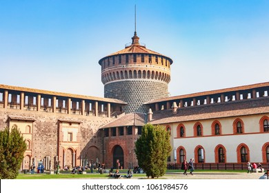 Milan, Italy - November 03, 2017: tourists walk in front of the Castle of Sforza on a fall day, a fortress built in the fifteenth century by Francesco Sforza, Duke of Milan